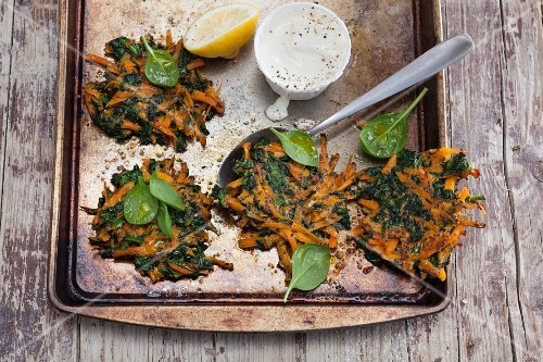 Vegetarian carrot and spinach fritters with a lemon dip
