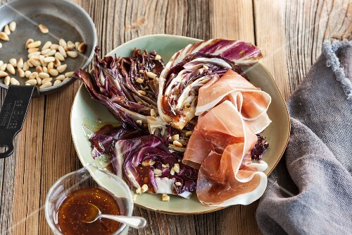 Roasted radicchio with air-dried ham and pinenuts