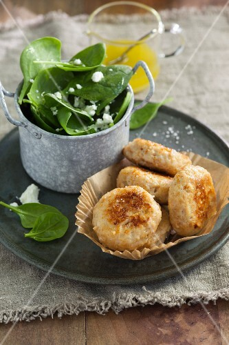 Turkey fritters with spinach and feta cheese salad