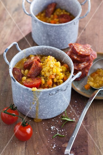 Yellow lentil stew with chorizo and cherry tomatoes