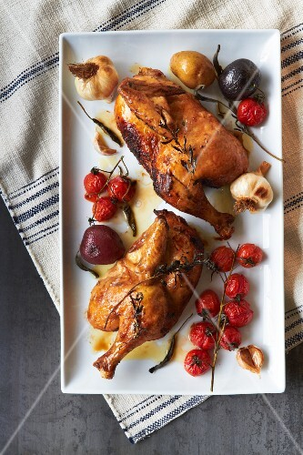 Half a roast chicken with cherry tomatoes