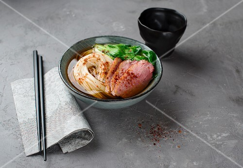 Oriental noodle soup with duck breast