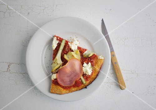 A slice of wholemeal pizza with artichokes