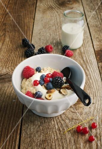 Porridge with wheat germ, berries and hazelnuts