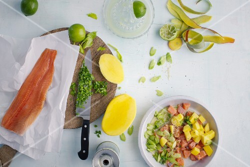 Ingredients for trout ceviche with mango and sesame seeds