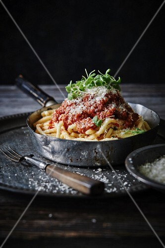 Linguine and meatballs with marinara sauce and grated cheese