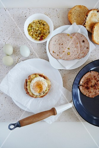 Fried mortadella sandwiches with fried eggs and relish
