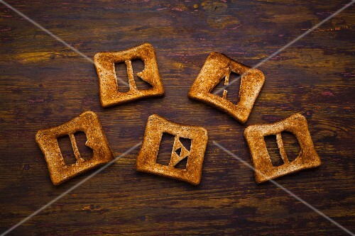 Letters cut out of slices of toast spelling the word 'bread'