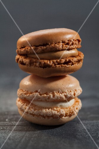 A vanilla macaroon and a chocolate macaroon