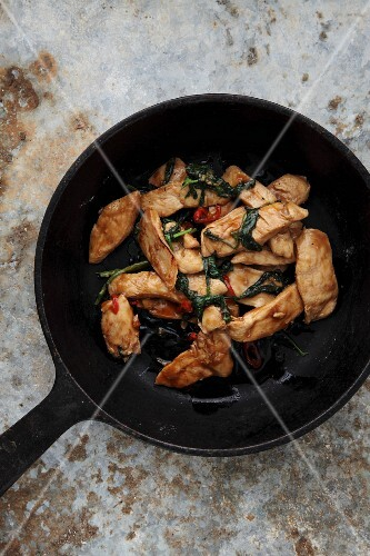 Chicken with Thai basil in a pan