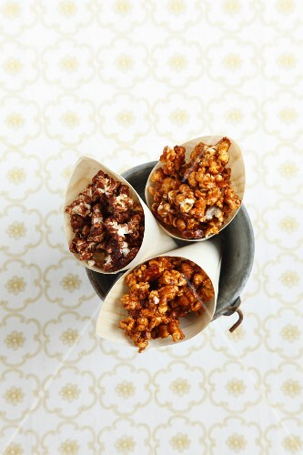 Caramel and chocolate popcorn in paper cones