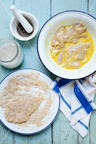 Chicken schnitzel being prepared