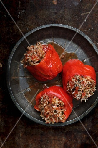 Red peppers filled with rice and minced meat in tomato sauce