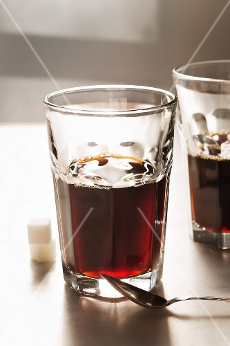 Glasses of coffee with sugar