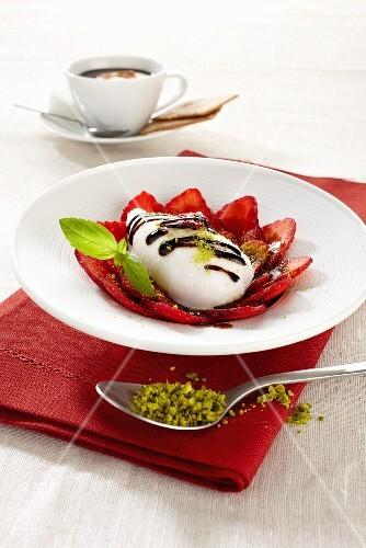 Mozzarella on a strawberry carpaccio with chocolate sauce