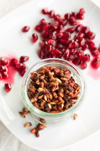 Organic pomegranate seeds, fresh and dried, in a jar for muesli
