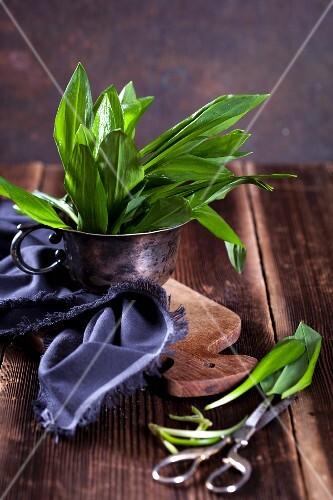 Fresh wild garlic on a wooden table