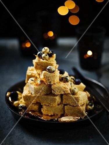 Burfi (Indian vanilla sweets) with golden blueberries