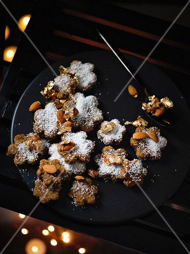 Laddu (Indian cakes) with figs, coconut and golden almonds