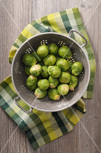 Fresh Brussels sprouts in a colander (seen from above)