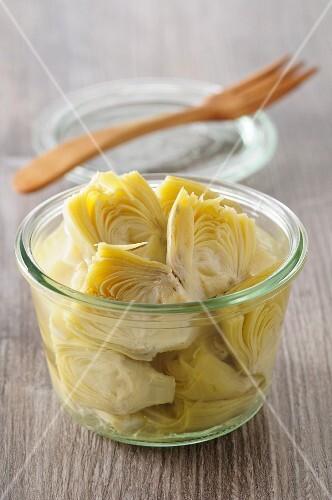 A jar of pickled artichoke hearts