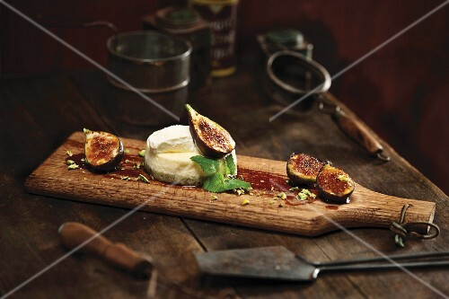 Goat's cheese with figs on a wooden board