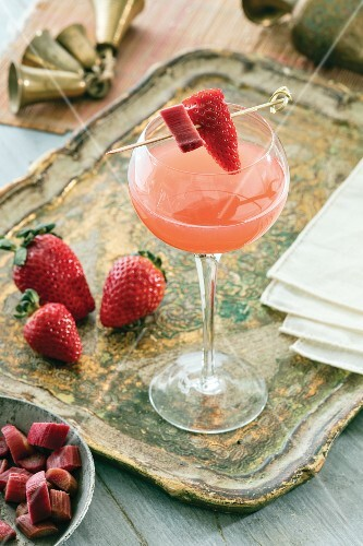 A champagne cocktail with rhubarb and strawberries