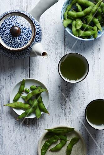 Edamame snacks served with tea