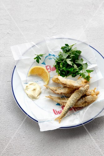 Fried breaded anchovies with mayonnaise and lemon