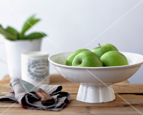Green apples in a white dish