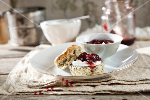 Poppyseed and lemon scones with cream cheese and amarena cherries