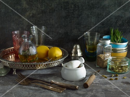 An arrangement of lemons, spices, oil and rosemary