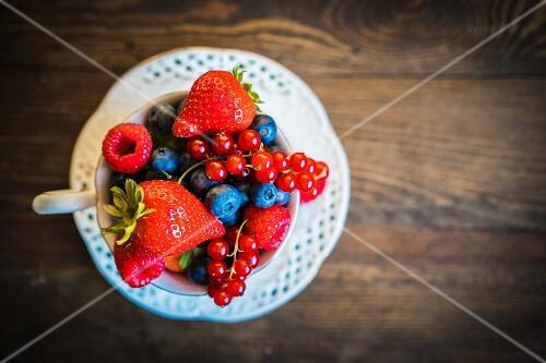 Fresh summer berries in a teacup