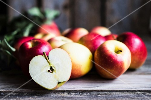 Apples on rustic wooden surface