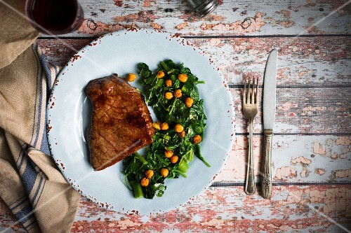 Beef steak with a chickpea and spinach medley