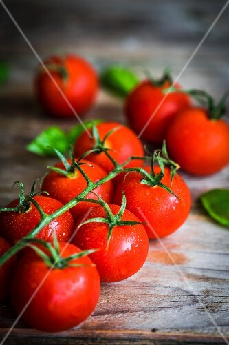 Tomatoes on rustic wooden surface