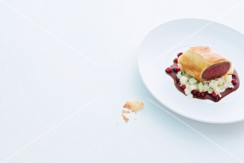 Venison fillet in strudel pastry on a bed of lingonberry sauce and kohlrabi