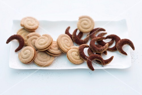 Spiced spiral biscuits and chilli and nut crescent biscuits