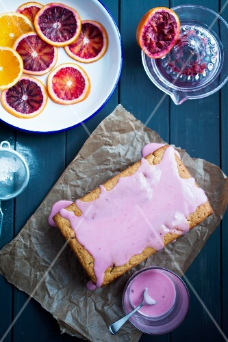 Vegan blood orange cake with pink blood orange juice glaze