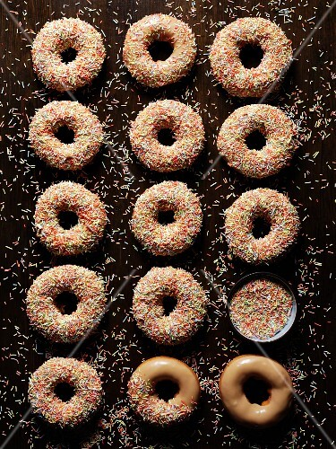 Caramel doughnuts with colourful sugar sprinkles