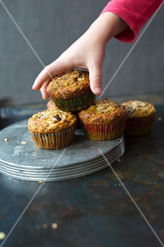 A child taking a turmeric muffin