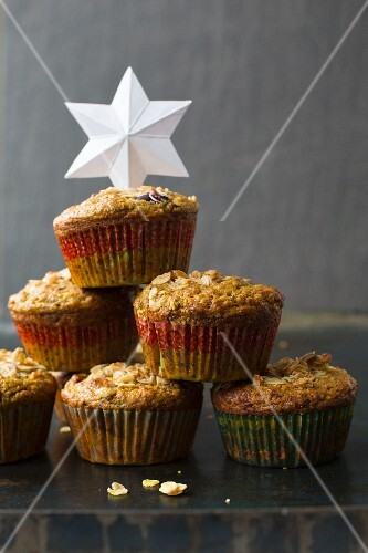 A stack of turmeric muffins with a paper star