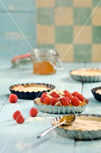 Raspberry tartlets with slivered almonds and jam
