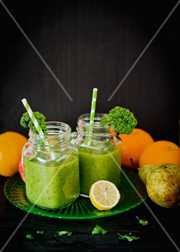 Green fruit smoothies with kiwi and parsley