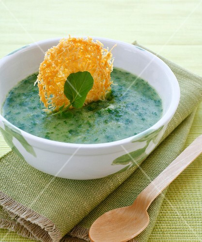 Cold watercress soup with a Parmesan wafer