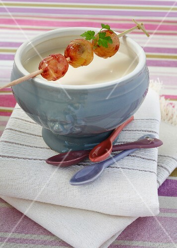 White bean and champagne soup with a great skewer