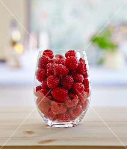 Fresh raspberries in a glass