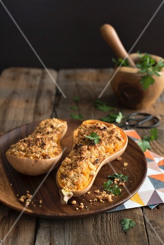 Butternut squash filled with breadcrumbs and Parmesan cheese garnished with parsley