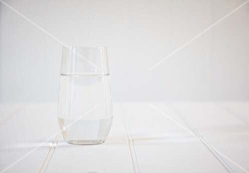 A glass of water on a white wooden table