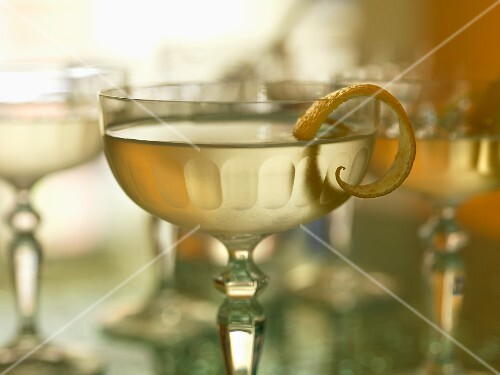 A cocktail with lemon peel